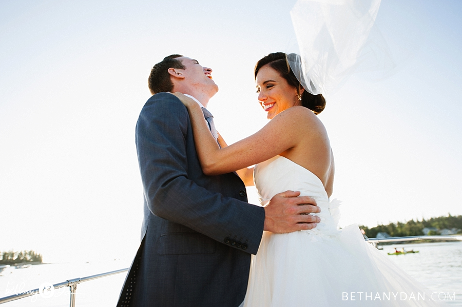 The bride and groom having fun on the boat