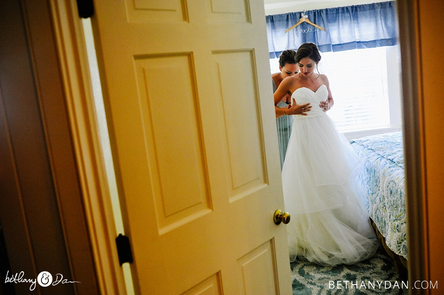 The bride getting in her dress in Southport Maine