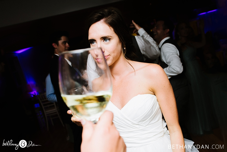 The bride and a wine glass reflection