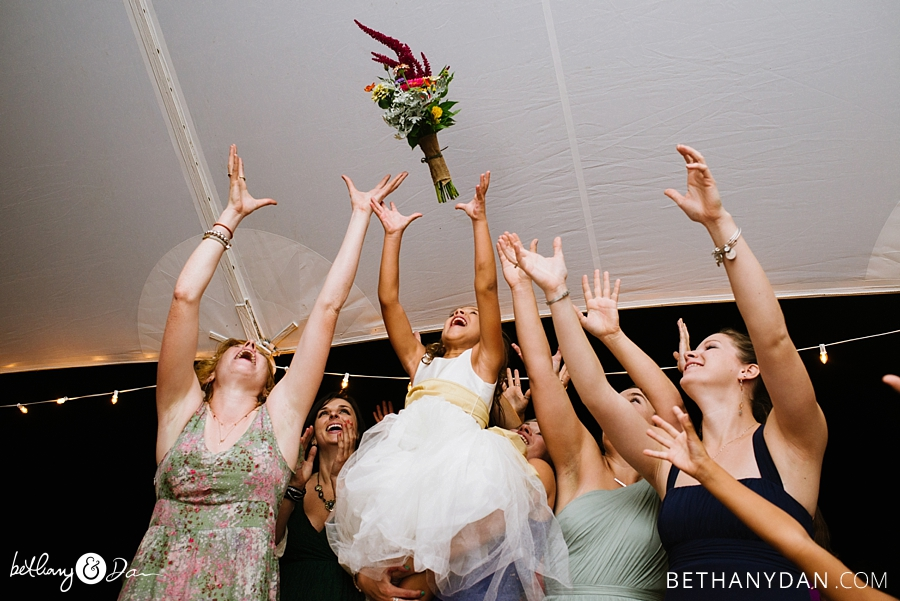 All the girls trying to catch the boquet