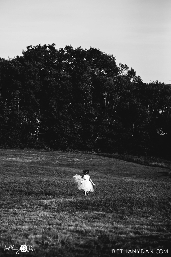 A flower girl running through the field