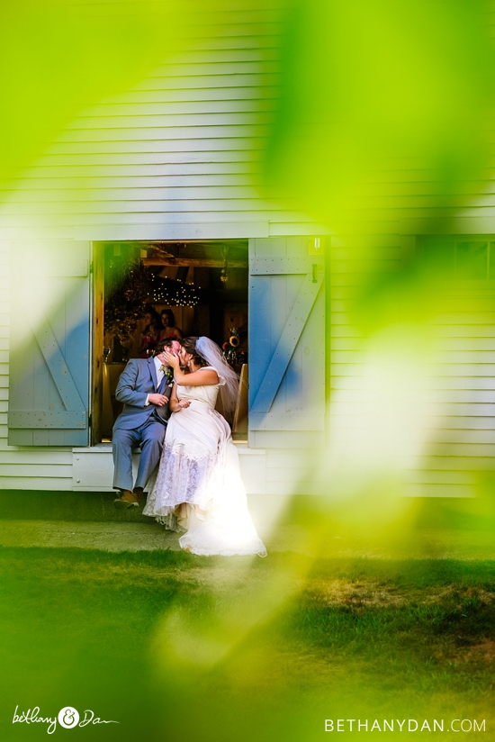 The bride and groom in the barn doors