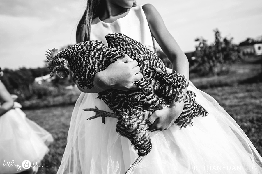 A flower girl and a chicken