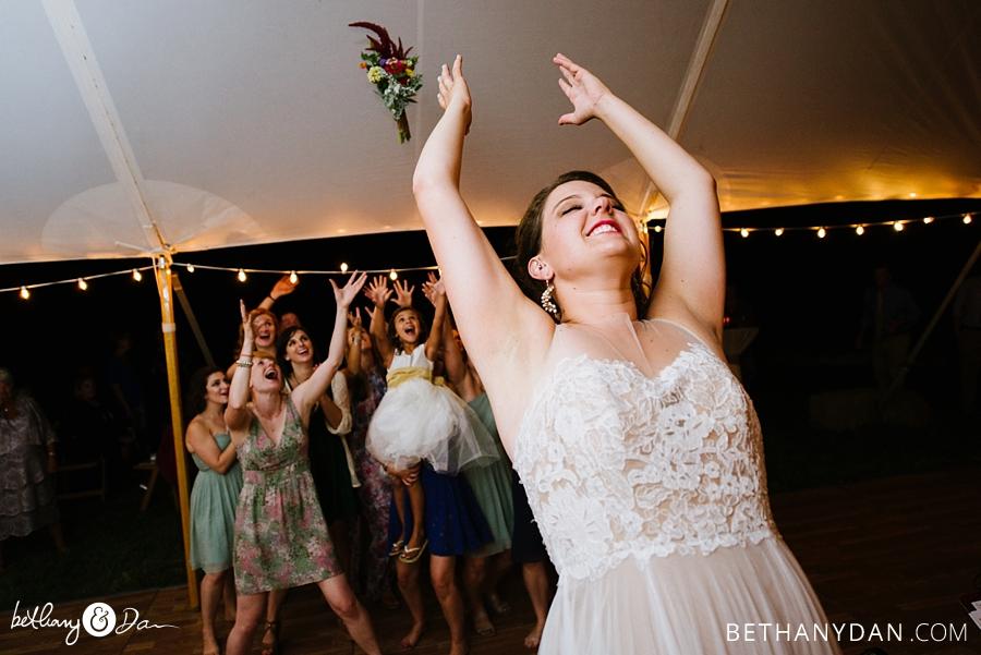 The bride tosses her boquet