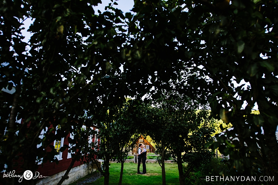 The grooms photographed through trees