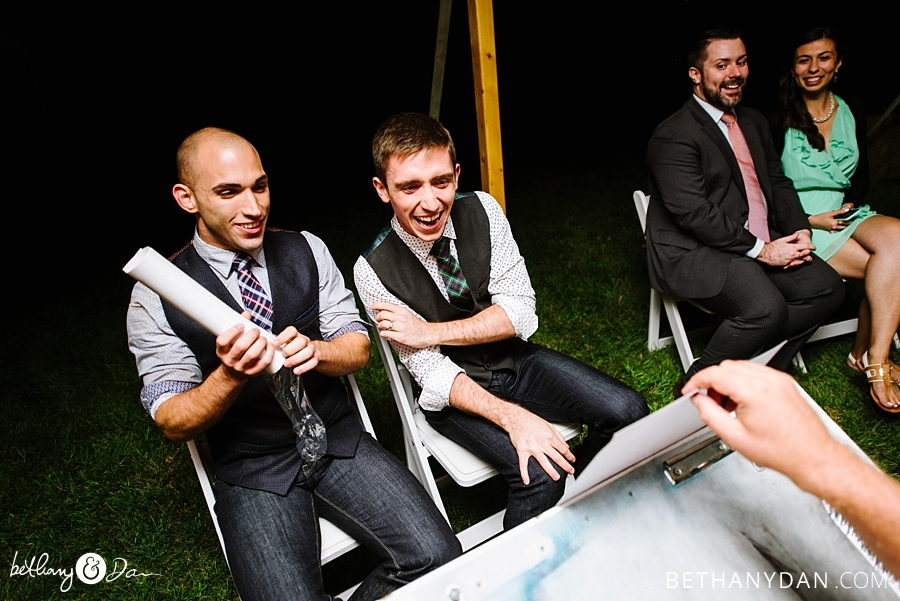 The grooms laughing